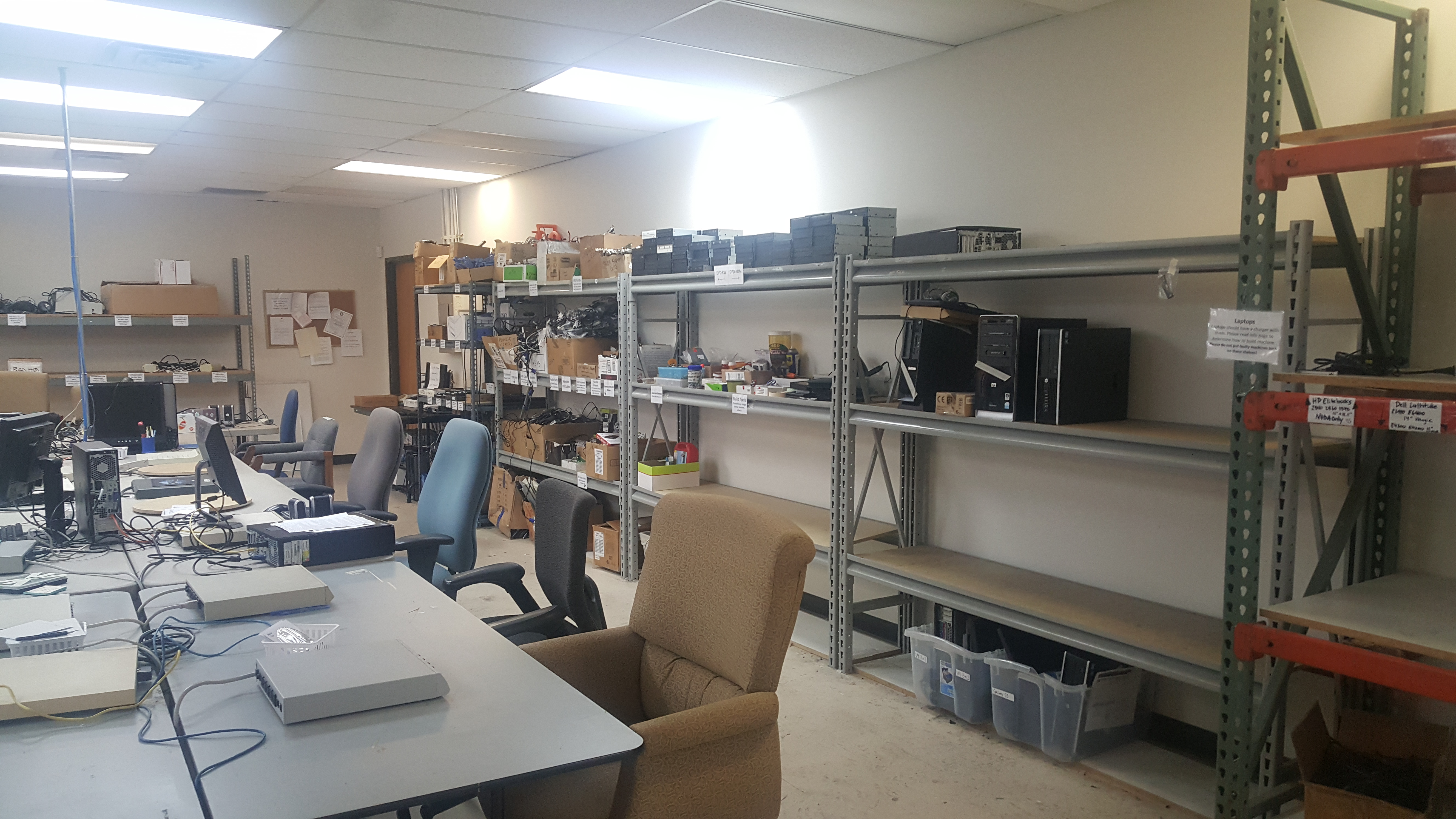The storage shelves in the Refurbishing Center in Richardson. These shelves contain all the peripherals that we use to build computers such as mice, keyboards, cables, and parts.