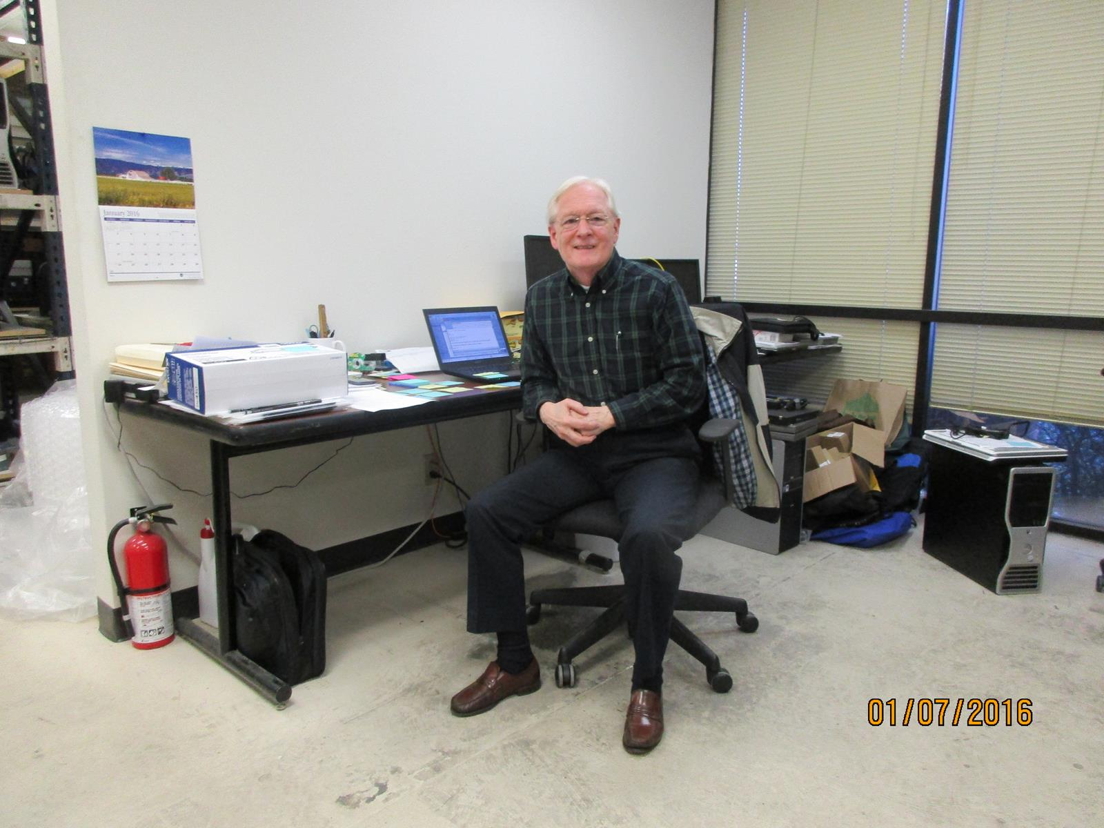 Gil sitting at his office. He has worked with CFTB for many years, and stills helps out often.