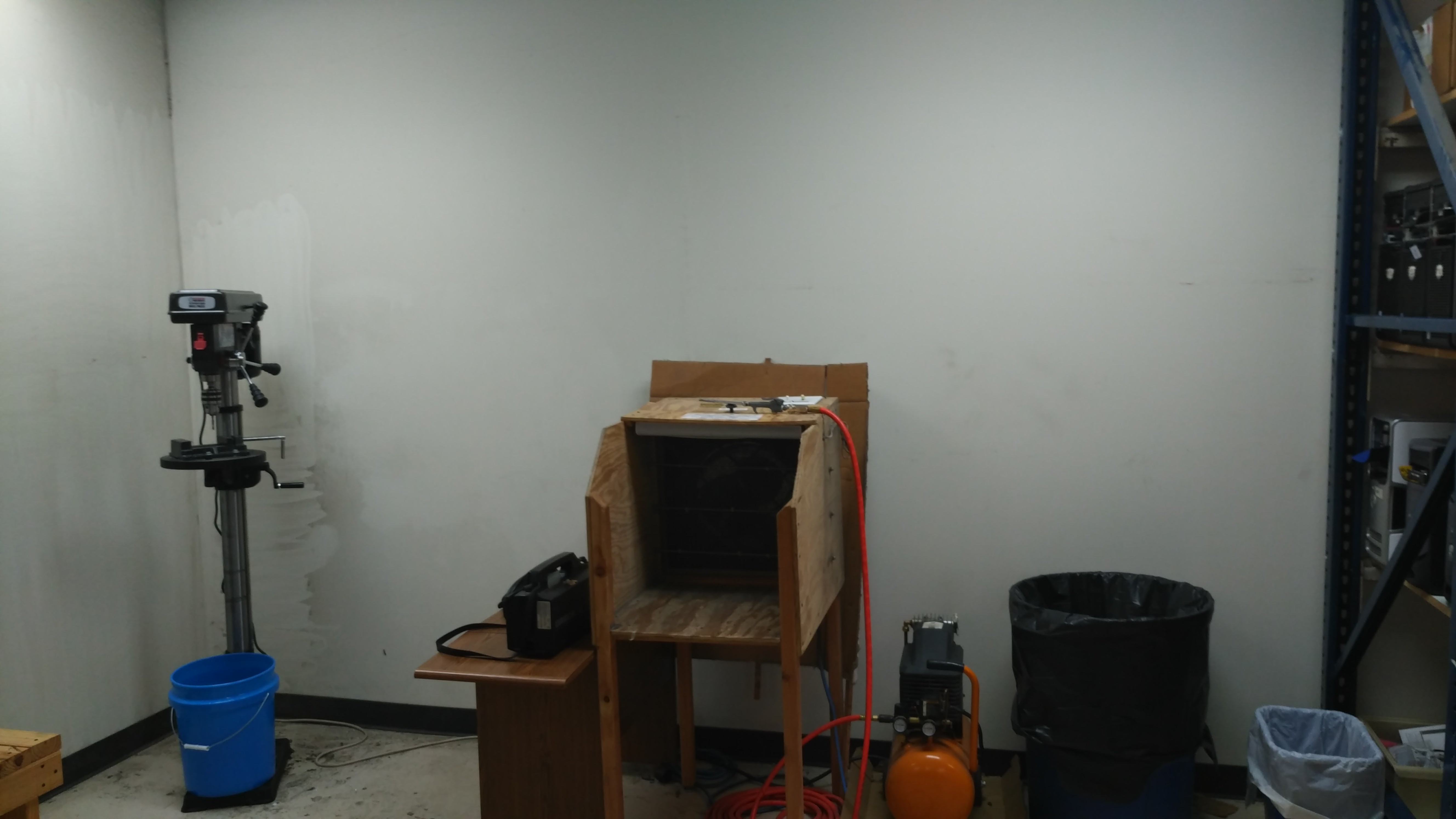 This is our tool corner. We use the drill press to destroy hard drives that cannot be used in computers, and the air compressor allows us to get inside the machine and blow all the dust out. This area was recently redesigned to allow us to get more done.