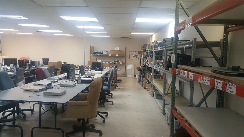 Volunteers workstations and storage shelves at the Refurbishing Center in Richardson.