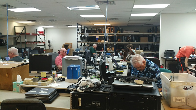 Some of our Volunteers are hard at work setting computers up for our Clients. We are open Monday through Thursday to prepare systems to ship out. Come join us!