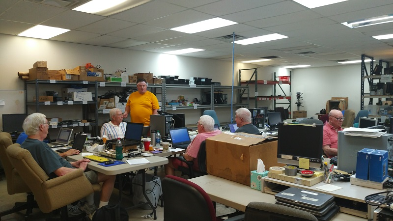 Our volunteers discussing something important (or not) while they take a couple minutes off from working on computers. We have volunteers that have been with us for many years, and others that have been working for less than a month, but it is always a great atmosphere!