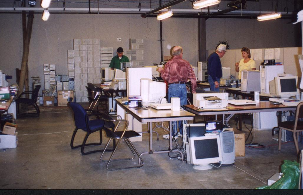 A scene of volunteers working in the old Refurbishing Location. The same work was getting done, but as you can see, the equipment was a little older back them. Many volunteers are still with us!