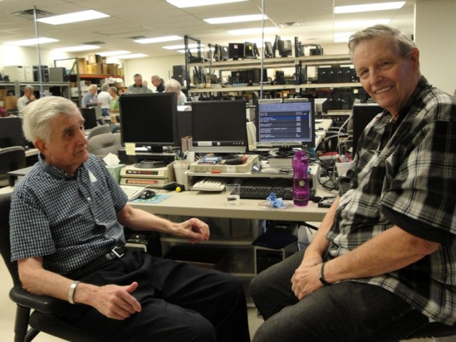 Bob and Pete catch up at our Refurbishing Center during the presentation of the 6000th computer.